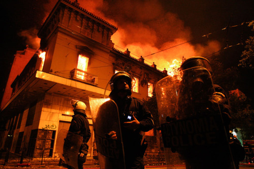 Athens in Flames Over the weekend, more than 45 buildings across Athens were set ablaze  by violent protesters. The fires began as the Greek Parliament passed a  strict package of austerity measures, in an effort to meet demands by  the European Union and the International Monetary Fund. The measures,  which were prerequisites for a $170 billion bailout, included steep  public-sector job cuts and a 20 percent reduction in the minimum wage.  More than 80,000 Greeks reportedly demonstrated in the streets of Athens  — among them, a small, violent group that hurled firebombs at riot  police and set dozens of fires. More than 120 police and protesters were  injured. The next step for the new austerity measures is  implementation, and that may face strong opposition as well. Collected  here are scenes from a weekend of unrest in Athens. [36 photos]