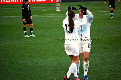 Alex Morgan & Abby Wambach post second goal celebration: awkward high fives edition.  USWNT v. New Zealand - Feb. 11 Frisco, TX