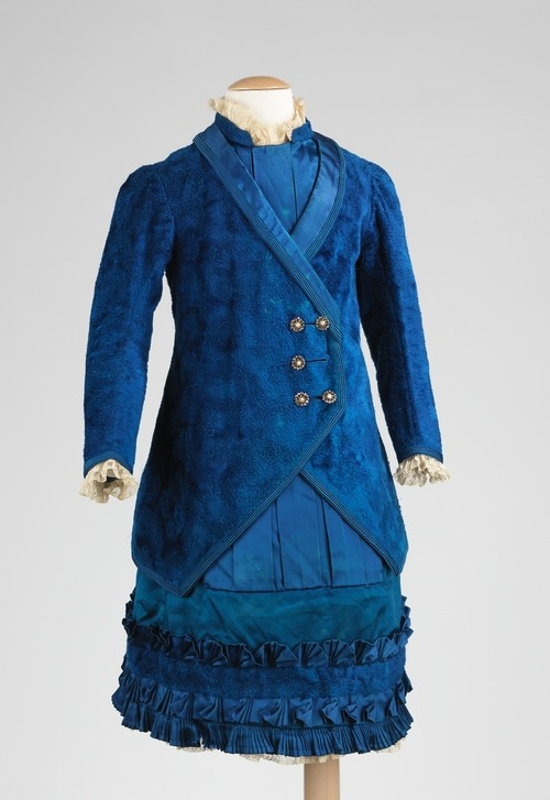 A beautiful girl's dress and coat ensemble made in France between 1885 and 1890.