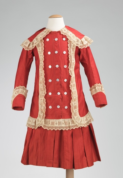 A girl's military-inspired cotton ensemble made between 1886 and 1888.