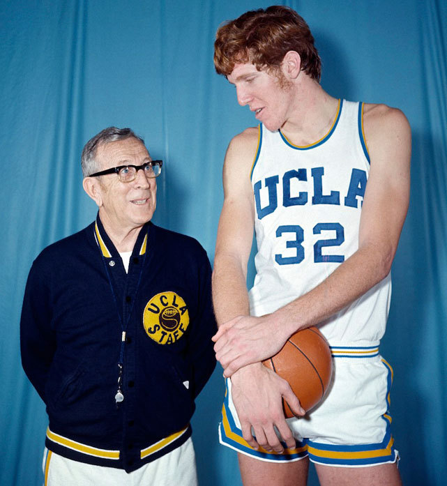 UCLA basketball coach John Wooden poses with player Bill Walton in this 1971 photo. Walton won two championships for the Bruins (1972, 1973) with Wooden as his coach. (REUTERS) SI VAULT: Walton, UCLA are feasting on their foes (3.6.72)