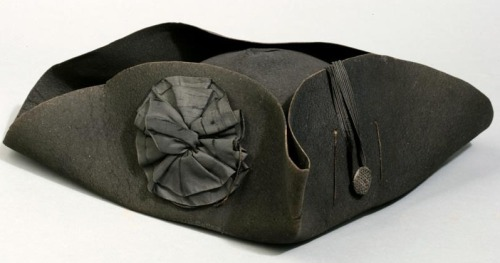"Revolutionary War Cocked Hat, 1776-1780. Via the New York Historical Society.  ""According to the accession records, this hat was worn by John Shethar of Connecticut, an ancestor of the donor. Shethar was made a lieutenant in the 2nd Continental Dragoons December 31, 1776, and promoted to captain October 11, 1777. He resigned from military service March 8, 1780.""  You know, for the ubiquity of the black cocked hat in our history, there really aren't that many that still exist today.  The gorgeous silk cockade is icing on the cake!"