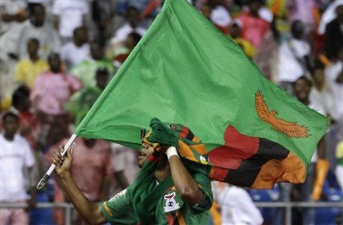 Zambia's Davies Nkausu runs with his national flag after winning the African Cup of Nations final soccer match against Ivory Coast at the Stade de l'Amitie in Libreville, Gabon, Sunday Feb. 12, 2012. (AP Photo/Themba Hadebe)