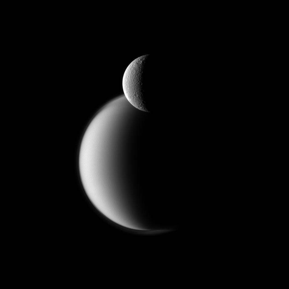 Two moons of Saturn captured by the Cassini spacecraft - Titan behind Rhea. (via Cassini Solstice Mission: Rhea Before Titan)