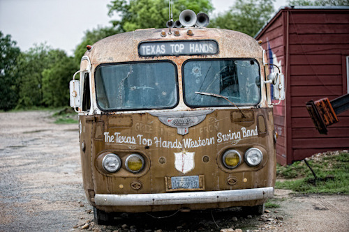 excessluggage:  Old tour bus parked outside a line dancing hall in Austin, Texas  We've seen a few of these roll up to the Fort. Speaking of Austin, who's going to be at SXSW?