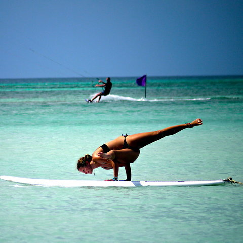 "HOLY SMOKES! fuckyeahyoga:  side crow variation on a paddleboard.  ""To be outside and all you see is the blue sky and the water, it's incredibly serene and it forces you to stay focused to keep your balance,"" Ms. Brathen said. ""You can't think about what you're having for dinner or the fight with your boyfriend."""