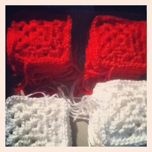 The squares are growinggg! (: #granny #square #blanket #small #red #white #box #crafts #crochet #personal  (Taken with instagram)