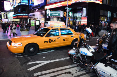 Yellow cab vs NYPD's bike.