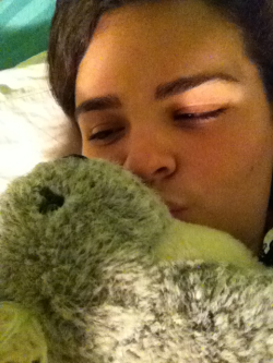Me kissin Mr. Koala beeks before bed. We're sleepy. I've gotta get up in the morning to make lunch for my baby between her classes :).
