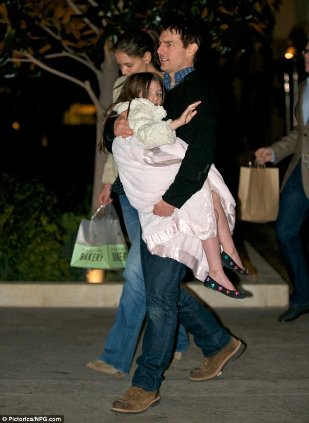 Suri Cruise still gets carried… She's two months shy of her sixth birthday, which is basically a teenager these days. So you'd think Suri Cruise might want to run a few steps of her parents to gain a little street cred. But the five-year-old princess was carried by father Tom Cruise, cradled in his arms while wrapped in a baby pink blanket, following a family outing to rather swish Beverly Hills eaterie Bouchon Bakery.