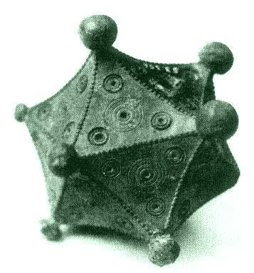 "Artmann also reports one Roman icosahedron, illustrated at left.  It is also hollow, bronze, and about 8 cm in diameter.  This only deepens the mystery as to the function of these objects. Interestingly, it was put away in a museum's basement storage, misclassified as a ""dodecahedron"" for forty years."