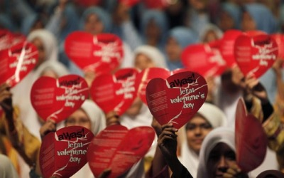 "theatlantic:  Malaysia Celebrates Valentine's Day by Arresting Unmarried Couples  Morality police in Malaysia kicked off Valentine's Day by raiding cheap hotel rooms to arrest more than 80 young Muslims trying to ""celebrate"" the holiday. The unmarried couples were charged with ""close proximity,"" which is basically being alone with a member of the opposite sex, a crime that is punishable by jail terms of up to two years. The raids took place almost immediately after midnight on Tuesday and focused on budget hotels and public parks, suggesting that the ""couples"" may not have been together that long, making them easy targets for morality warriors. Read more. [Image: Reuters]"