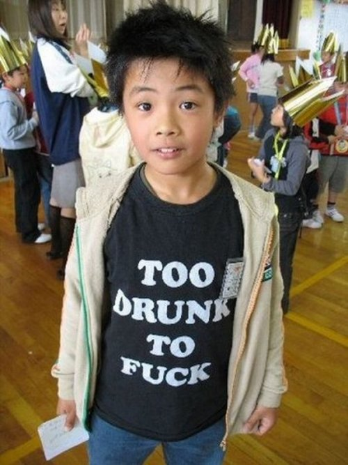 collegehumor:   Little Kid Wears Unfortunate Shirt   His dad passed it down to him, because, apparently, he wasn't.  [Like following us on Tumblr? Fan us on Facebook!]