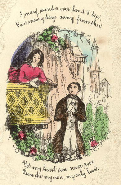 Circa 1860: A Victorian St Valentine's Day card with a lace paperwork border.