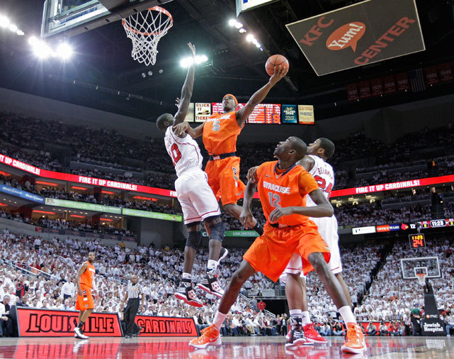 Syracuse's C.J. Fair avoids Louisville's Gorgui Dieng during last night's Orange-Cardinals game. Syracuse survived 52-51 to snap a seven-game losing streak to Louisville. (Photo by Andy Lyons/Getty Images) POWER RANKINGS: Syracuse holds steady at No. 2