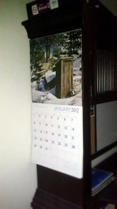 Hehe, BroBro is using the calendar I bought him. That is an outhouse. XD  (Photo by infiniteambience)