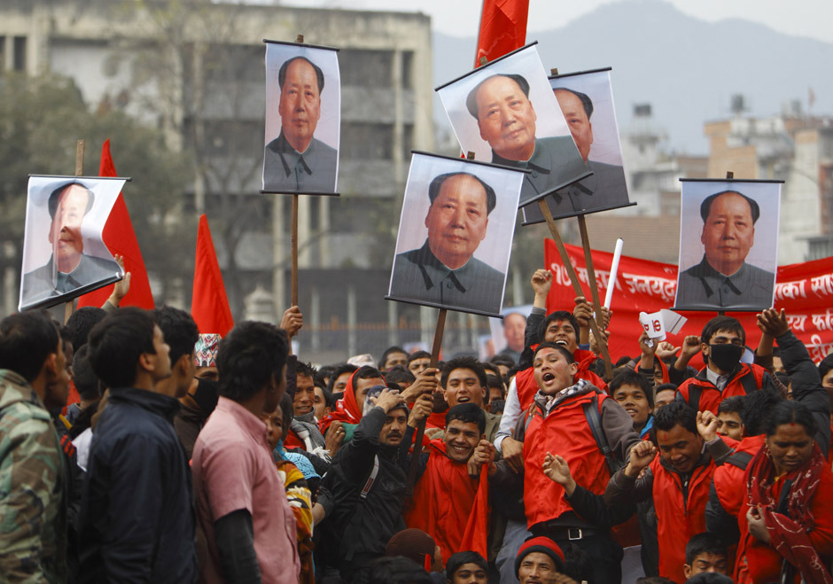 "Supporters of Unified Communist Party of Nepal (UCPN-Maoist) carry portraits of former Chinese chairman Mao Zedong during a rally marking the 17th anniversary of the ""People's War"" in Kathmandu February 13, 2012. According to local media, thousands of communist supporters gathered for a mass meeting at the Open Air Theatre. The UCPN-Maoist started the war on February 13, 1996 demanding for the end of the monarchy, as well as for an election to the Constituent Assembly. [Credit : Navesh Chitrakar/Reuters]"