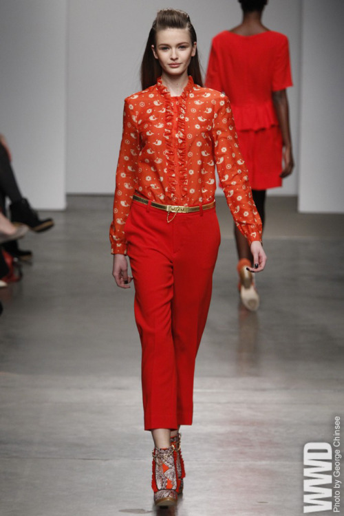 womensweardaily:  Karen Walker RTW Fall 2012  Karen Walker enriched her usual cool and  quirky clothes with a Victorian-age romanticism, showing ruffled  necklines and hems on jackets and skirts before going for a more Mod  feel via short dresses in vibrant colors and oversize paisley prints  that made for an upbeat collection.