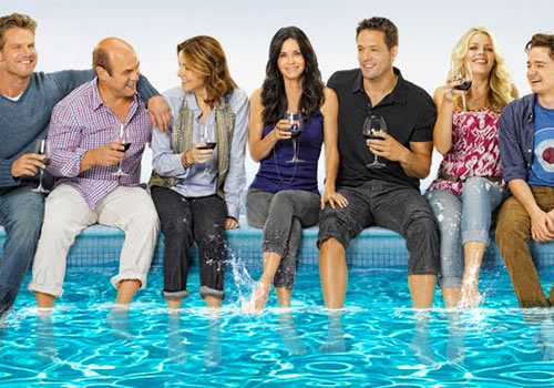 "The third season of Cougar Town premieres tonight and this is officially a plea for you to watch it. Ignore the title. Give it a chance. Just trust me on this one, okay? Every person that I know who watches this show had originally avoided it solely because of the title and the fact that no one really wants to watch a bunch of middle-aged women bang younger guys. But it's not that show. The cougars went extinct very, very early in the first season. Now it's about a bunch of friends who hang out, drink impressive amounts of wine, and have fun. It's about starting over and valuing your friendships and knowing that being an adult doesn't always have to mean, well, being an adult. Remember the early episodes of How I Met Your Mother and how it made you and your friends decide that you want to be those characters when you grow up? You wanted to hang out in a bar in New York City and drink beer and pull pranks on each other? That's how Cougar Town feels — except warmer.  There's so much to love about Cougar Town. The writing is fantastic. There are hilarious running gags (the Penny Can game and the silly songs are two of my favorites) that have yet to get old. Busy Phillips absolutely kills in her role. These aren't women who are crying about how they need a man, these are women who are owning the walk of shame and wearing it like a badge of honor. The dialogue is quick and witty. There are movie parodies, a giant dog who delivers beer, and a demon child. Bill Lawrence, as he's already proved on Scrubs, is arguably the best writer when it comes to balancing comedy and drama. There are scenes of broad hilarity followed by scenes that will quietly hurt your heart. It's a show that, at the end of the day, is simply about the characters and their relationships with each other and therefore our relationships with them.  But the thing is most people have already made up their mind on whether or not they're going to watch the show based solely on the title and assumed premise. So here's something: give it a chance solely to support television and good people. In the last few weeks, Bill Lawrence, the crew, and the cast have been crossing the country and throwing parties to support the show. They talked to the fans on the internet, they gave out free t-shirts and penny cans and bottles of wine (!), they footed the bill for open bars, they stuck around after the screenings to autograph giant wine glasses, discuss their favorite gags, and simply shoot the shit with anyone who wanted to talk. TV Hangover went to three of these screenings — two in New York City and one in Boston — and it was this new and amazing form of guerilla marketing that we'd never seen before. They went past the simple hashtag ""save this show"" and went to ""hey, grab a friend, come watch some episodes, and get wrecked on wine on our dime. Talk to us and let us know what you like or don't like."" It's something that I really want to see more of. Not just because wine is my lifeblood or because I want to be a television writer so it's comforting to see a show that I love work hard to stay on the air, but because it's such a beautiful thing to see people care so much about their job and who believe so much in their work that they're willing to go above and beyond to promote it. And it's not just their show; at both of the screenings I attended, Bill Lawrence mentioned Community and how much they all love it. He talked about how cross-pollination should be a big part of the future of television. Don't just promote your show, but promote the shows you love! It's a trait I hope most showrunners pick up, especially when their respective networks aren't exactly doing the promoting themselves. And it works! I, along with plenty of other people I talked to, watched Cougar Town because of the crossover episode with Abed from Community and ended up sticking around. It's a nice brotherhood that you don't see much on television. So hey, give Cougar Town a shot tonight even if it's just in support of good television, and people who care about good television, and people who support the good television that you love. Give them a shot because they're working so hard to stay on air just to make you laugh. Give them a shot because they're trying which is so much more than you can say about so many shows that are floating around existing. Give them a shot because it's actually a funny show. Or, you know, just give them a chance because there's nothing else to watch on television and it's only a half hour out of your life. Grab a bottle of red wine, take a drink whenever the characters do, and soon you'll be drunk and happy which is really all you need to be on Valentine's Day."