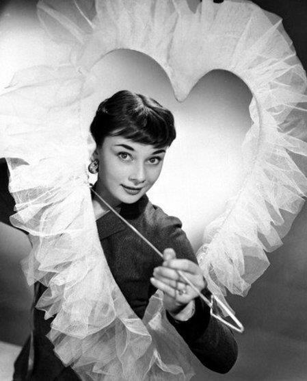 Love is all around. maliciousglamour:  Audrey Hepburn