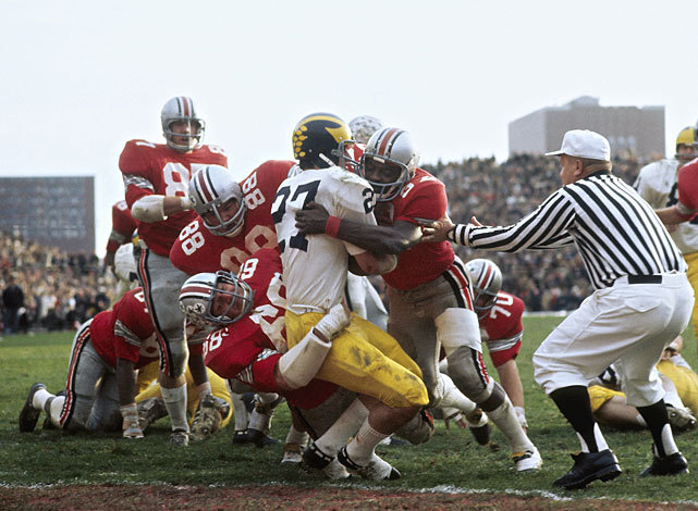 Ohio State safety Jack Tatum and defensive end Jim Stillwagon tackle Michigan's Don Moorhead during a 1970 game between the Buckeyes and Wolverines. (Walter Iooss Jr./SI)  GALLERY: Top 10 Michigan-Ohio State Games Since 1950