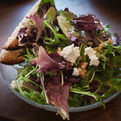 Salad with feta and walnuts, garden lettuces and balsamic vinaigrette at Caffe 817, Oakland, CA.