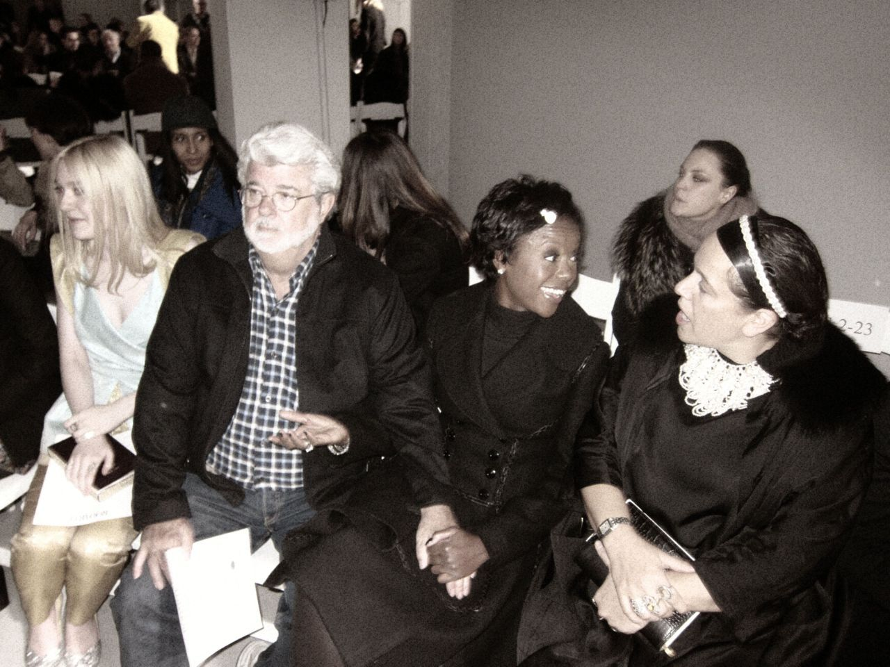 George FREAKIN' Lucas (!) at today's Rodarte show with his wife Melody, Dakota Fanning, and Michelle Obama's right styling hand Ikram Goldman.
