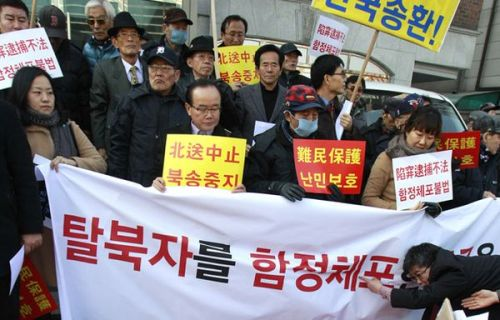 "Demonstrators protests China's arrests of North Korean defectors  REPORTING FROM SEOUL -– Angry demonstrators staged a rally Tuesday near the Chinese Embassy here to protest China's arrests of dozens of North Korean defectors who face torture, imprisonment and even death if returned to their homeland. For years, human rights advocates have criticized China's refusal to recognize North Korean defectors and its policy of returning, or repatriating, all escapees from the North captured on its soil. Beijing's stance has taken on more urgency in recent weeks, after new North Korean leader Kim Jong Un vowed to punish and even kill three generations of family members of anyone who tries to leave the impoverished North. On Tuesday, ringed by police officers, more than 100 people gathered across the street from the Chinese Embassy, waving banners that read ""The Chinese government should stop pushing North Korean defectors toward the guillotine"" and ""Forced repatriation is a death sentence."" Pictured: South Korean activists stage a rally on behalf of North Korean refugees arrested by Chinese authorities. Credit: Lee Jin-man / Associated Press"