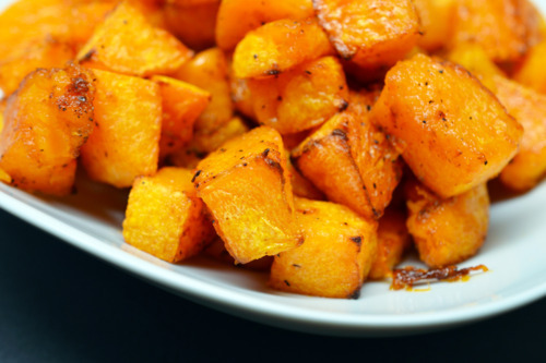 Cubed paleo and Whole30 roasted butternut squash on a plate.