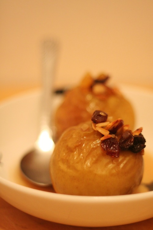 Felt like some warm comfort food this evening. Baked Apples Recipe: 4 small to medium apples about 6 prunes 1/4 cup of raisins 1/4 cup of cranberries 1/4 cup of slivered almonds 1 tbsp coconut palm sugar 1 tbsp agave syrup 1 tsp vanilla 1 tsp cinnamon 1/4 tsp nutmeg 1/2 tbsp Earth Balance Vegan Butter Use an apple corer to remove centers of apples, make sure you leave the skin on the outside. Mix together all other ingredients except for the Earth Balance. Stuff as much of the mixture that you can in each apple, it's o.k if it looks like it's going to burst. Put a little dollop of the Earth Balance on top of each apple, right in the center so it melts down into the filling when baking. Bake at 350F for about 45 minutes. Check them a couple times because there will be a lot of juice in the pan and basting these a couple times while cooking makes them extra delicious. I poured a little coconut milk over top to serve but Coconut Bliss ice-cream would be even better.