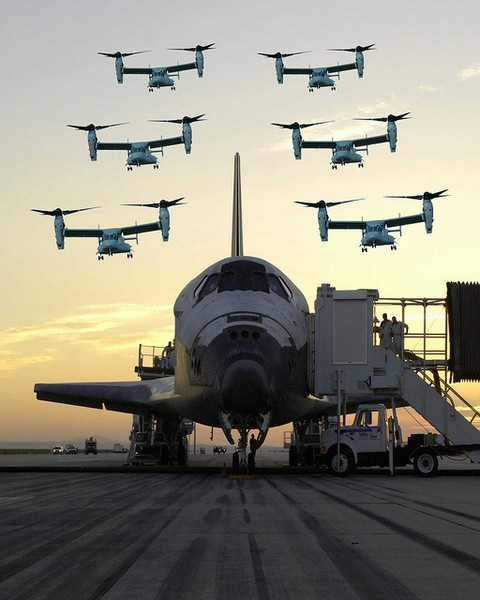 scanzen:  awesomeandcmyk:  Six Bell Boeing V-22 Ospreys for welcome home.   this one is poorly photoshopped fake image of Discovery here is the original without the osprey stamped six times caption for the original file. STS114-S-049 (9 August 2005) —- The sun rises on the Space Shuttle Discovery as it rests on the runway at Edwards Air Force Base in California, after a safe landing at 5:11 a.m. (PDT) on August 9, 2005. The landing concludes a historic 14-day, Return to Flight mission to the International Space Station.