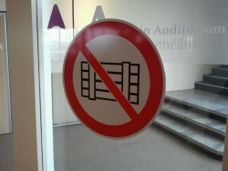 Mysterious sign on the door of the Main Auditorium. Does anydody knows what it stands for?