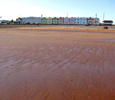 The red sands of Paignton beach in Devon.