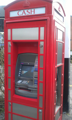 Half phonebooth, half cash machine. Brilliant