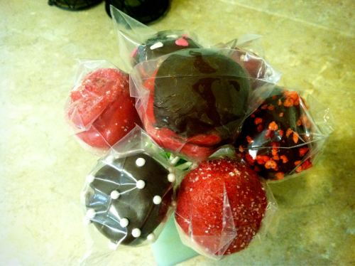 Cake pops!!! (it's hard to see since they are already wrapped, but the red one to the left is a rose)