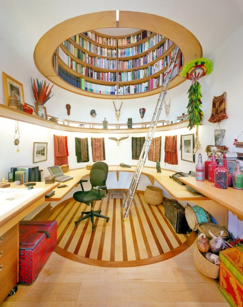 Amazing office space is crowned with a circular loft library (via DesignRulz)