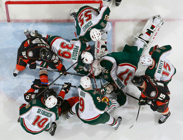 Anaheim's Jason Blake (33), Corey Perry (10), and Ryan Getzlaf (15) attempt to free the puck while Devin Setoguchi (10), Nate Prosser (39), Mikko Koivu (9), Nick Schultz (55) and Dany Heatley (15) surround their goalie Josh Harding (37) as he attempts to cover up the puck during last night's Ducks-Wild game. Anaheim scored two third period goals to win 2-1. (Bruce Kluckhohn/NHLI via Getty Images) POWER RANKINGS: Where do Anaheim and Minnesota rank this week?
