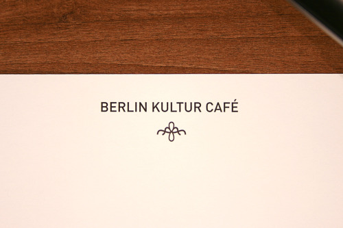 Berlin Kultur Café Visual Identity/Logo Design/Graphic Design Berlin Kultur Café is a fictional, cultural café/museum/studio, which offers a starting point for starting artists. The goal of the assignment was to create a logo and corporate identity, using fauna or flora, and a particular city. The logo created refers to a flourishing flower, representing the growth the artist will experience. It was then made into a pattern. The chosen city, Berlin, demanded a modern look, but with a special twist.Includes a logo, letterheads, some business cards and envelopes.