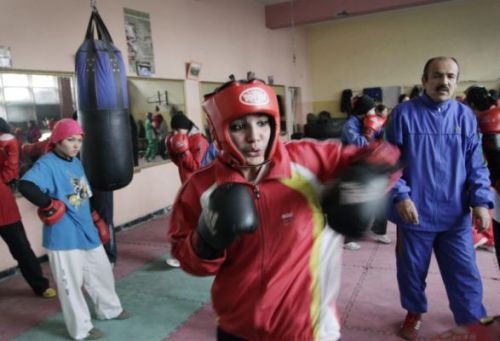 "muslimwomeninhistory: Afghan Woman to box in Summer Olympics || Feministing  Afghan boxer (yes, you read that correctly, boxer) Sadaf Rahimi will  be representing Afghanistan in the women's boxing competition at the  London Olympics this July. Not only will this be the first time that  women's boxing will be featured at the Olympics, she will be the only  woman from Afghanistan at the event. In the Summer games of 2004 Robina Muqimyar and Friba Rezayee became the first women to represent Afghanistan at the Olympics, making  Rahimi the third woman in history to represent Afghanistan at the  Olympics. She speaks about the pressure she faces:  ""When we participate in the outside competitions, there  is pressure on us, but I will try to show that an Afghan girl can enter  the ring and achieve a position for Afghanistan."""