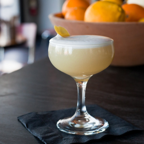 Dolores del Río cocktail, by Hanjiro Ambrose, made with El Tesoro Platinum tequila, lemon, sherry, calabrian pepper syrup, egg white and grapefruit peel, at Adesso, Oakland, CA.