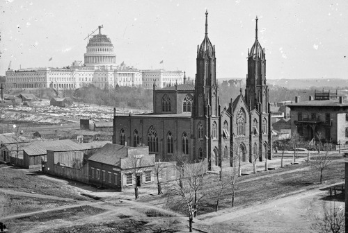 agirlirl:  1863  Trinity Episcopal Church, 3rd & Ind. Ave. Unfinished Capitol in the background. c.1863-64. By Mathew Brady.