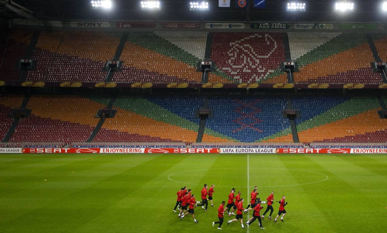 Manchester United players warm up during their training session at the Amsterdam Arena stadium in Amsterdam. Manchester United will play their Europa League soccer match against Ajax Amsterdam on Thursday. Photo: REUTERS/Robin van Lonkhuijsen/United Photos