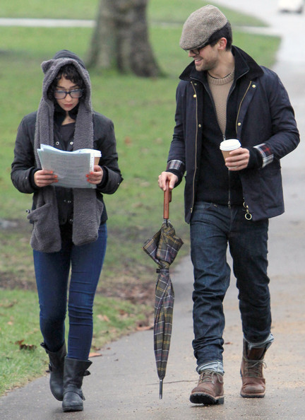 Dominic Cooper takes a stroll with a mystery qoman in the rain