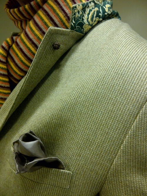 brokeandbespoke:  This jacket was from the first batch of sport coats I had made in Beijing back in 2006. This one has fairly closed front quarters, a 3 button stance (with a pretty hard roll—it's my main gripe with this jacket), double vents, fairly structured shoulders, and some Chinese silk brocade on the underside of the collar.