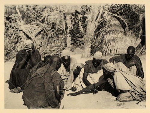 A group of Kanuri (Kanouri, Kanowri) men playing dice at Dikwa, Nigeria, Africa.1930