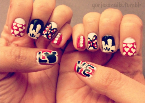 My Valentine's Day nails.. Disney themed. ♥ I realized after that my Mickey hand was a backwards 'I love you' sign. Lol!