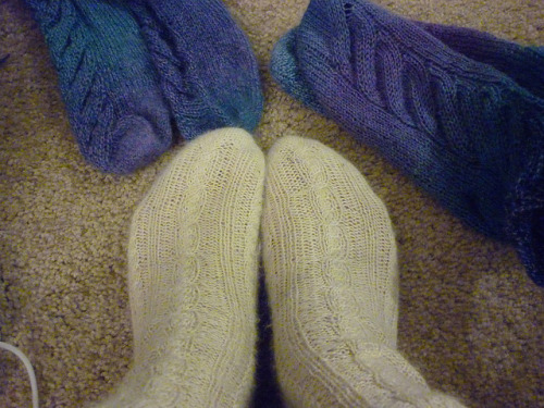 The first three pairs of socks I knit. These were all done between Thanksgiving 2011 and February 2012. The white ones are alpaca/bamboo, and the others are wool. So much warmer than the cotton tube socks I've been wearing for years! Knitting my own wool socks is clearly a thing that must continue. Tonight I cast on for my first sweater. Black fingering weight alpaca. Very soft.