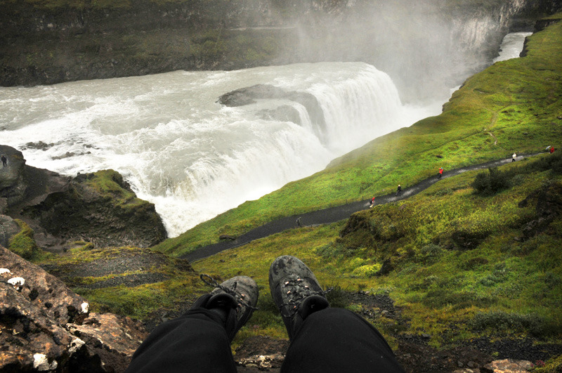 My feet hanging over the cliff above Gulfoss waterfall, Iceland. ✈ SEATTLE