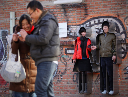 A chinese couple takes a picture in an interactive installation art work named 'You and Me' on Valentine's Day at 798 Art Zone in Beijing, China. Valentine's Day has become one of the most popular Western festivals celebrated in China. (Feng Li/Getty Images) (via Seeing red: Valentine's Day 2012 - The Big Picture - Boston.com)