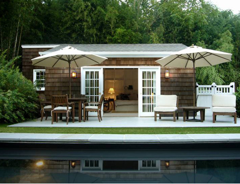 Pool Side: Simple, direct, modern garden design. A renovated fisherman's cottage on Shelter Island designed by architects Schappacher White. Photo by Laura Moss.